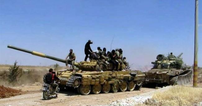 Bomb in Syrian capital kills 10 soldiers