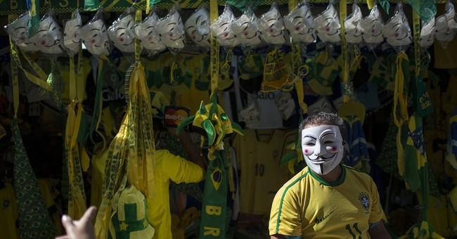 Brazil protesters, police clash near match