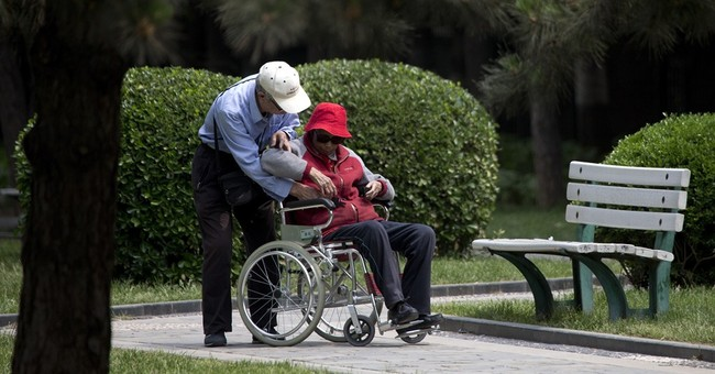 Law requires Chinese to visit their aging parents
