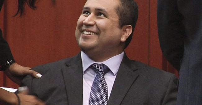 Officials: Zimmerman helped 4 out of wrecked SUV