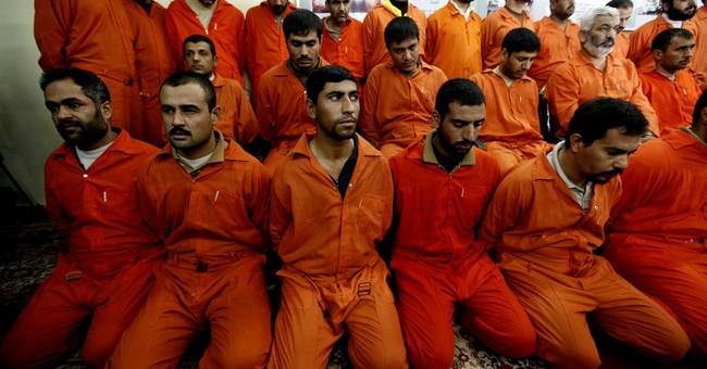 Al-Qaida claims deadly prison raids in Iraq