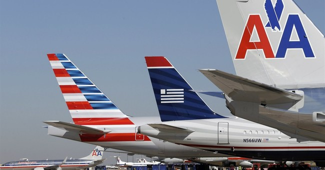 Airlines stocks tank as DOJ challenges merger