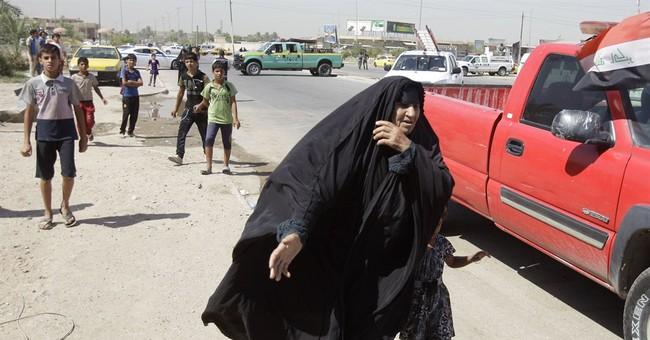 Car bombs hit Iraqi capital, killing 33 people