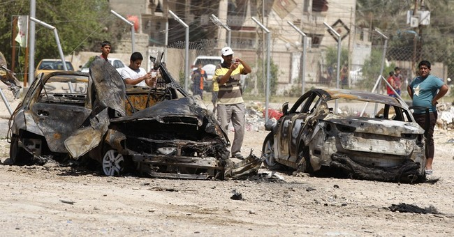 Car bombs hit Iraqi capital, killing 33 people