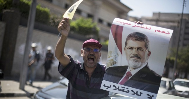 Egypt shortens curfew as unrest over coup wanes