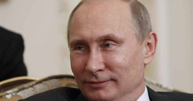 Putin hails Syria's action on chemical weapons ban