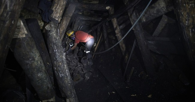 AP PHOTOS: Colombia villagers pray mines stay open