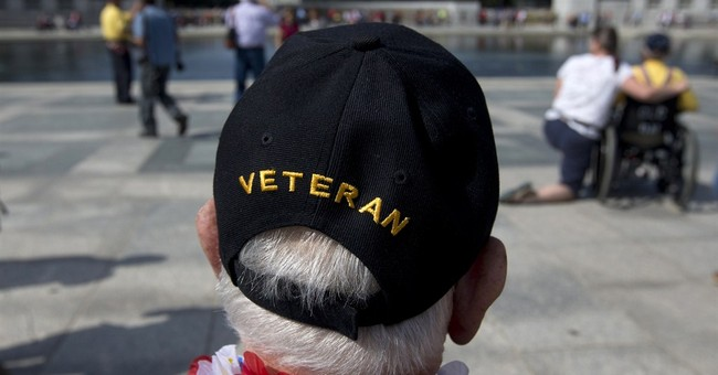 Veterans pass barriers at closed WWII Memorial