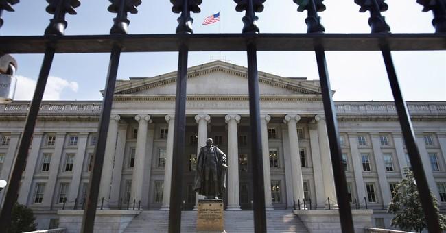 As US default nears, investors shrug off threat
