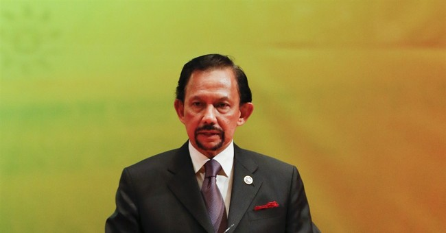 Brunei's sultan announces strict Islamic penalties