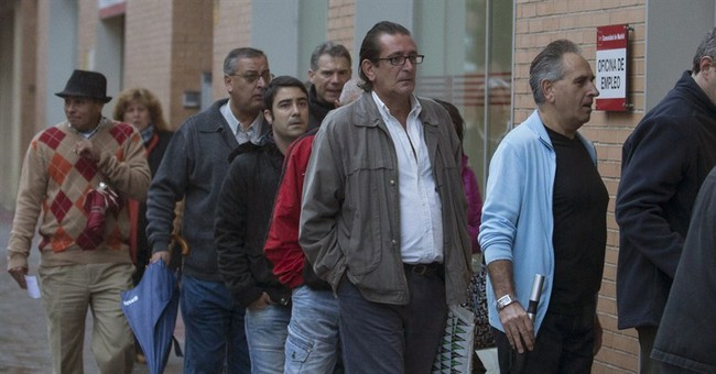 Spain jobless rate edges down amid tepid recovery