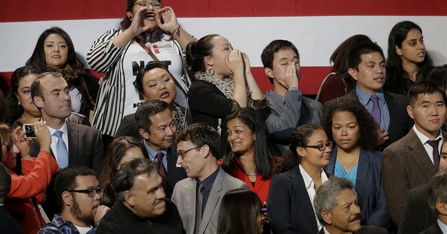 Anti-deportation protester interrupts Obama speech