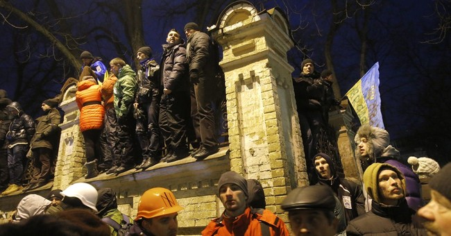 Ukraine mass protests resume after gov't wins vote