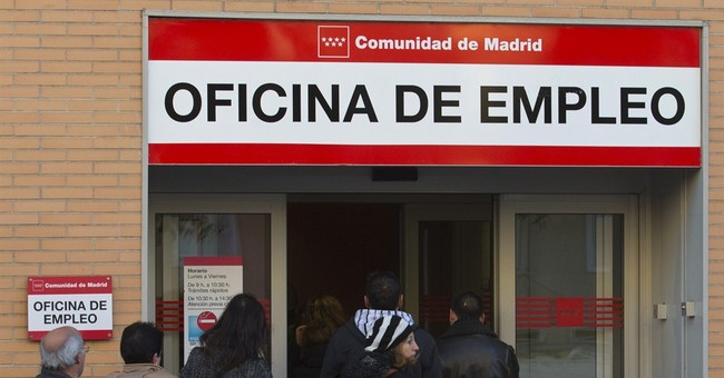 Spain's Nov jobless falls for 1st time since 1997