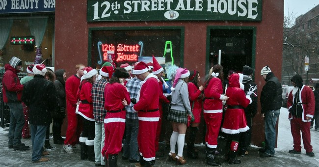 Hundreds of suited-up Santas hit NYC streets, bars