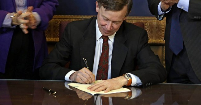 Colorado governor signs landmark gun bills