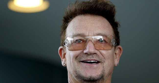 Rocker Bono Thanks America for Good Deeds in Africa