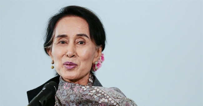Suu Kyi, Germany's Merkel discuss Myanmar's future
