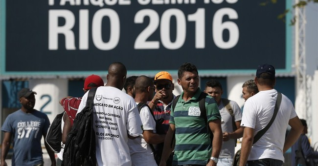 Olympic workers defy court order, stay on strike