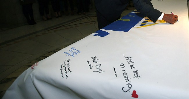 Governor signs huge Boston Marathon prayer canvas