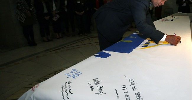 Governor signs huge Boston Marathon prayer canvas
