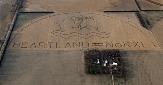 Opponents carve anti-pipeline message into field
