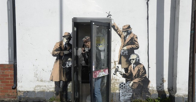 Fans think Banksy behind artwork mocking UK spies