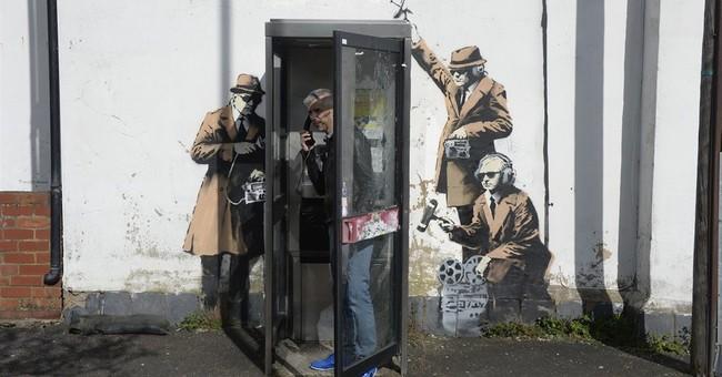 Fans think Banksy behind artwork mocking UK spies
