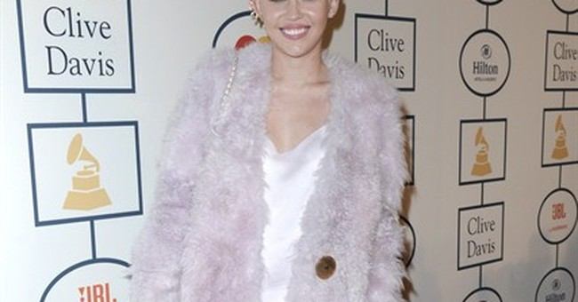 Ill, hospitalized Miley Cyrus postpones more shows