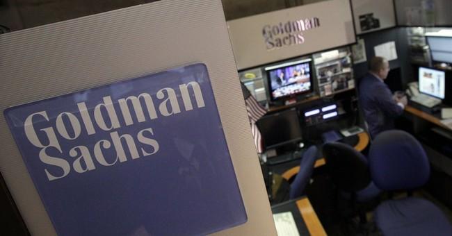 Goldman's income falls 11 percent, but still beats