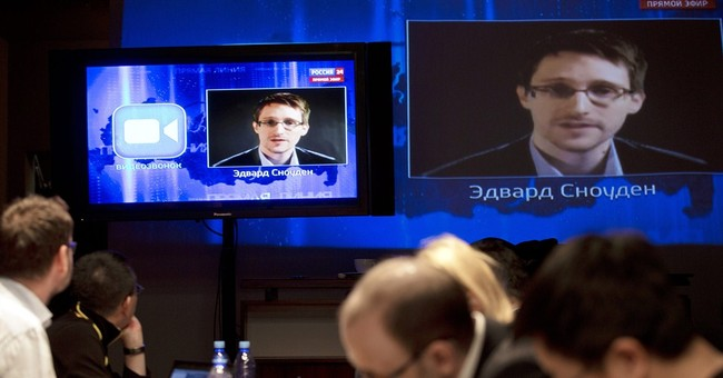Snowden questions Putin on surveillance policies