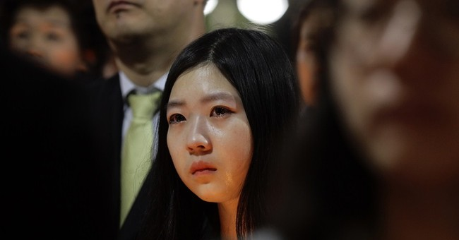 Grief in town of students missing in ferry sinking