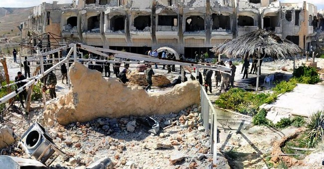 Syrian state TV: 14 killed in car bombing in Homs