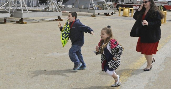 AP PHOTOS: Sailors return from 9-month deployment