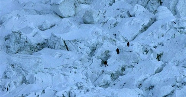 Avalanche sweeps down Everest, killing at least 12