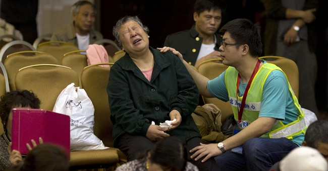 Chinese relatives pray over lost Malaysian plane