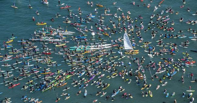 Hundreds paddle out for surf icon Hobie Alter