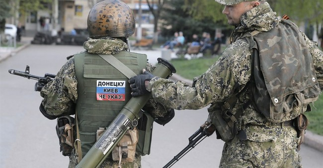 At barricades, Ukraine insurgents await Easter