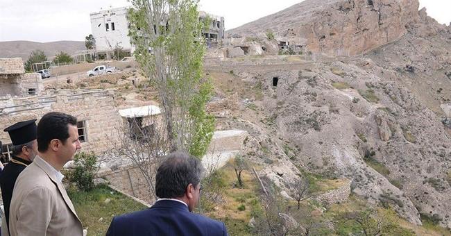Ahead of vote, Syria's Assad visits seized village