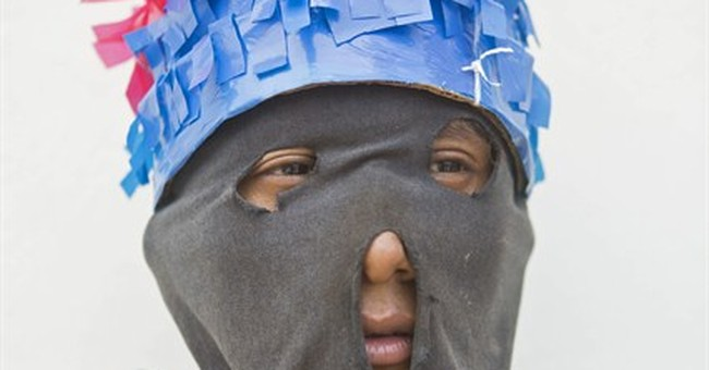 AP PHOTOS: Nicaraguan town drags chained 'Judases'