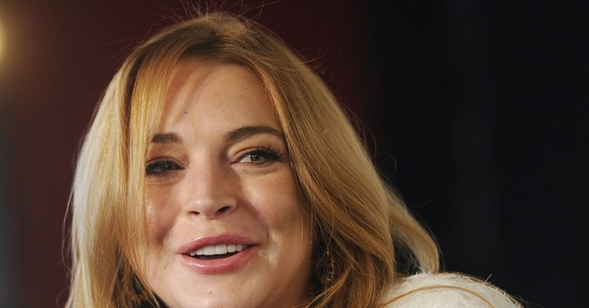 Lohan says on reality show she had miscarriage