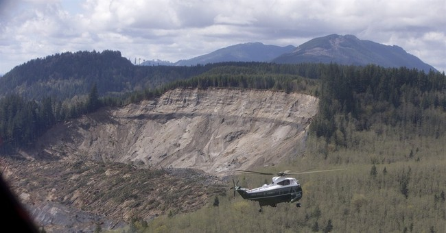 At mudslide scene, Obama mourns with survivors
