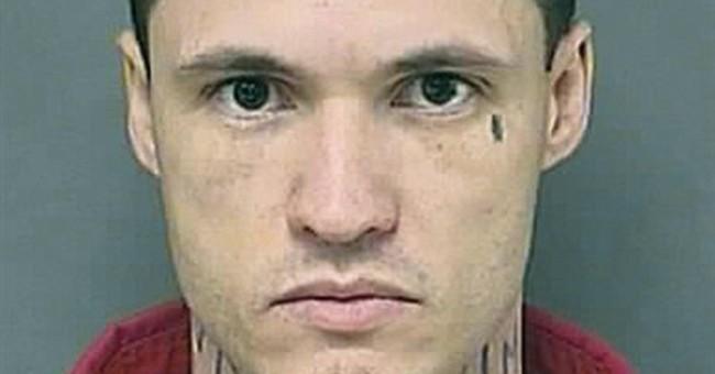 Man seeks to hide 'murder' tattoo before trial