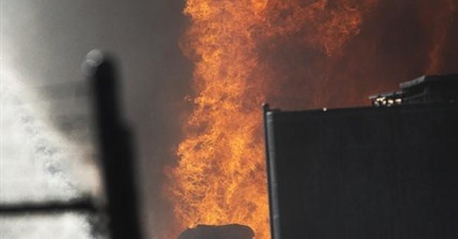 Phoenix fire sends up plume of smoke near airport