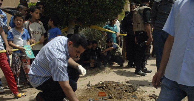 Bomb, shooting in Egypt kills 2 police officers