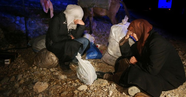 AP PHOTOS: Syrians on treacherous trek to safety