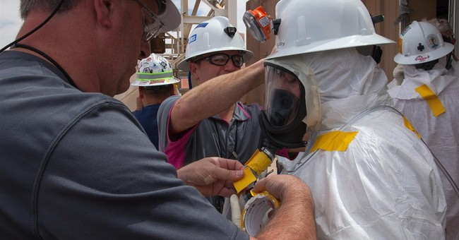 Management, safety cited for radiation release