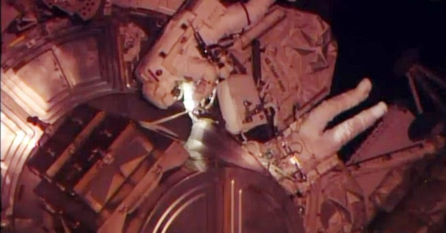 Spacewalking astronauts complete urgent repair job