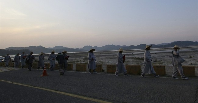 SKorea ferry toll hits 159 as relatives wait