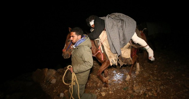 AP PHOTOS: Syrians on treacherous trek to safety